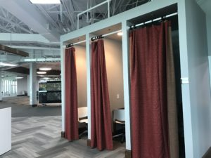 Need some quiet work time or visiting from another office? Just pull the curtain for instant office. Photo courtesy of Mohawk.