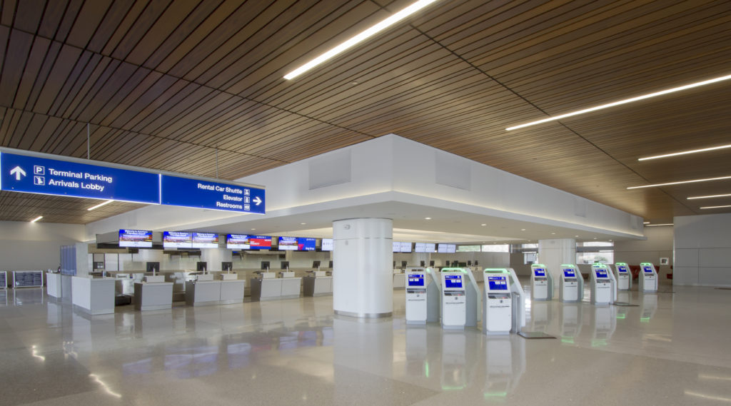 Metal Linear Multi-Box Continuous ceiling systems resembling individual wood slats were specified for lower levels along security checkpoints. The linear system required precise design, planning, and installation due to its modular nature and randomized perpendicular lighting.