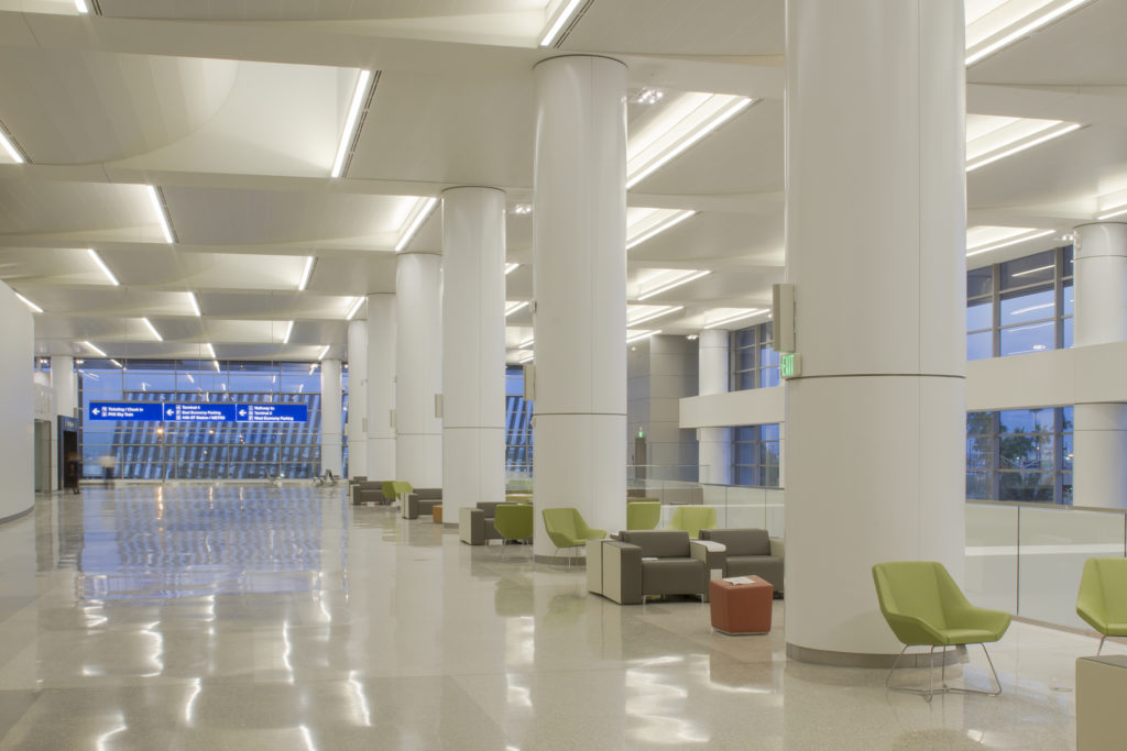 Multi-radius Torsion and Segmented Torsion Spring scalloped ceiling systems in a white finish were installed both flat and curved along the terminal's upper floors to accommodate previously designed skylights.